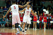 DALLAS, TX - JANUARY 21: Keith Frazier #4 of the SMU Mustangs celebrates with teammate Markus Kennedy #5 after a made three-pointer against the Rutgers Scarlet Knights on January 21, 2014 at Moody Coliseum in Dallas, Texas.  (Photo by Cooper Neill/Getty Images) *** Local Caption *** Keith Frazier