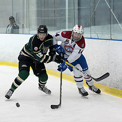 KINGSTON, ON - MAR 9,  2017: Ontario Junior Hockey League, playoff game between the Cobourg Cougars and Kingston Voyageurs, Danny Bosio #14 of the Kingston Voyageurs battles for the puck along the boards with Jesse Baird #12 of the Cobourg Cougars during the 1st period.<br /> (Photo by Ian Dixon/ OJHL Images)