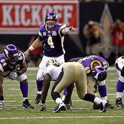 September 9, 2010; New Orleans, LA, USA;  Minnesota Vikings quarterback Brett Favre (4) under center during the NFL Kickoff season opener at the Louisiana Superdome. The New Orleans Saints defeated the Minnesota Vikings 14-9.  Mandatory Credit: Derick E. Hingle