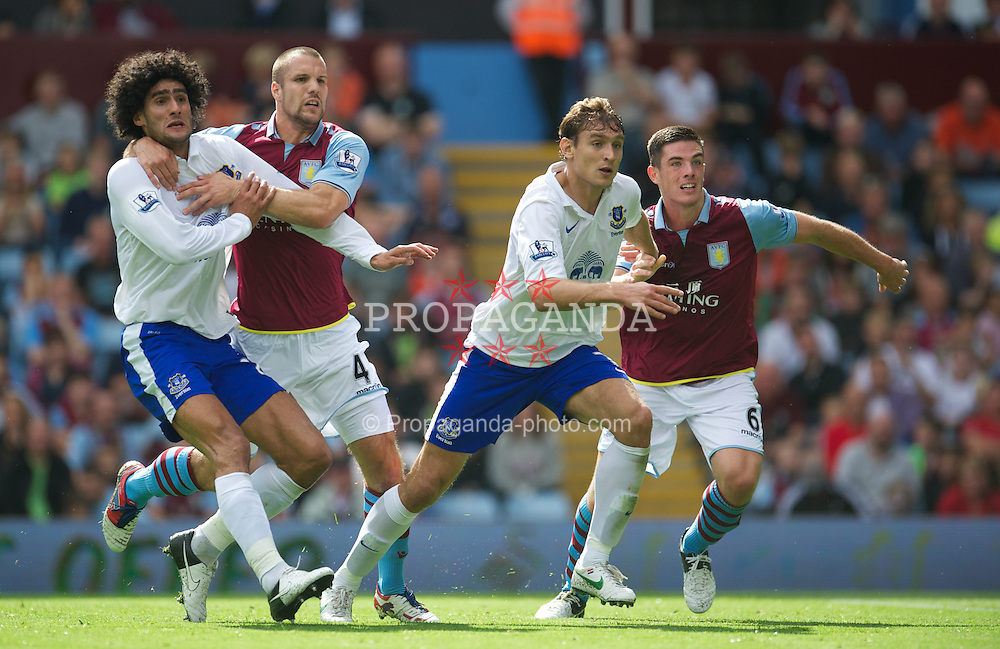 BIRMINGHAM, ENGLAND - Saturday, August 25, 2012: Everton's Marouane Fellaini and Nikica Jelavic in action against Aston Villa's Ron Vlaar and Ciaran Clark during the Premiership match at Villa Park. (Pic by David Rawcliffe/Propaganda)