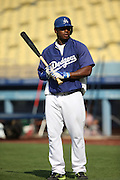 LOS ANGELES, CA - JULY 29:  Yasiel Puig #66 of the Los Angeles Dodgers looks on during batting practice before the game against the Atlanta Braves at Dodger Stadium on Tuesday, July 29, 2014 in Los Angeles, California. The Dodgers won the game 8-4. (Photo by Paul Spinelli/MLB Photos via Getty Images) *** Local Caption *** Yasiel Puig