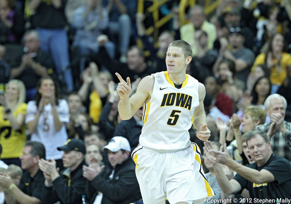 January 14, 2011: Iowa Hawkeyes guard Matt Gatens (5) after a three point basket during the NCAA basketball game between the Michigan Wolverines and the Iowa Hawkeyes at Carver-Hawkeye Arena in Iowa City, Iowa on Saturday, January 14, 2011. Iowa defeated Michigan 75-59.