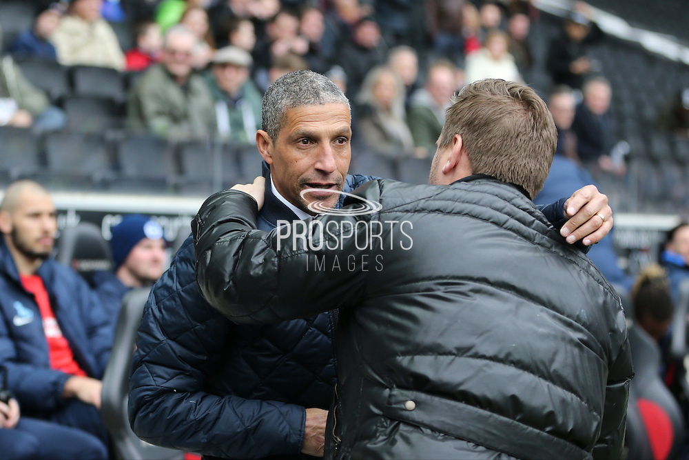 Brighton Manager, Chris Hughton and Milton Keynes Dons manager Karl Robinson embrace before the Sky Bet Championship match between Milton Keynes Dons and Brighton and Hove Albion at stadium:mk, Milton Keynes, England on 19 March 2016.