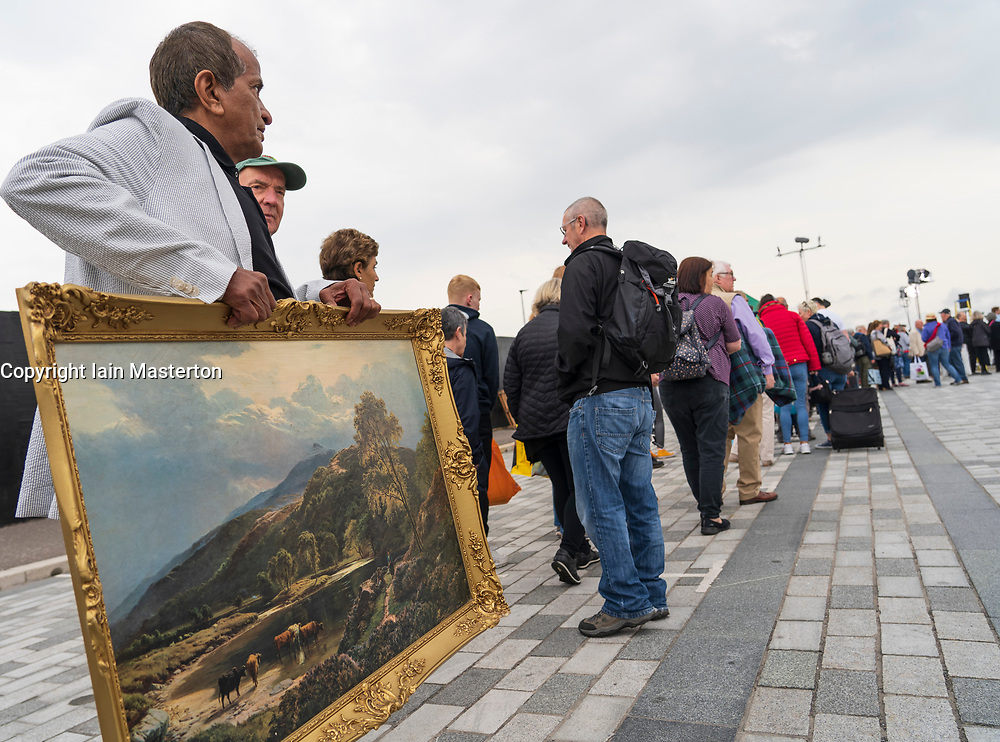 Dundee, Scotland, UK. 23 June 2019. The BBC Antiques Roadshow TV programme is aiming on location t the new V&A Museum in Dundee today. Long queues formed as members of the public arrived with their collectables to have them appraised and valued by the Antiques Roadshow experts. Select items and their owners were chosen to be filmed for the show. Pictured, Long queues formed as owners waited to have collectables valued.