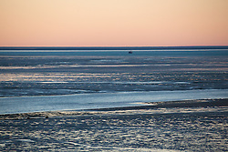 Dawn breaks over Dampier Creek in Roebuck Bay, Broome, on a spring tide.