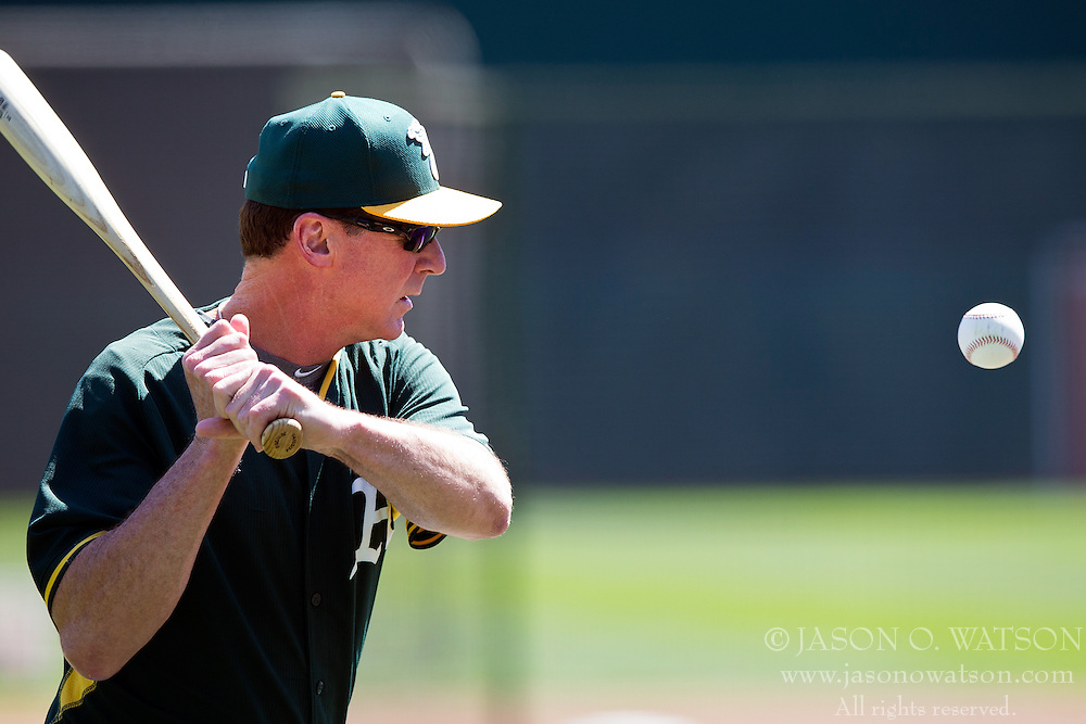 OAKLAND, CA - JUNE 21:  Bob Melvin #6 of the Oakland Athletics hits ground balls during batting practice before the game against the Los Angeles Angels of Anaheim at O.co Coliseum on June 21, 2015 in Oakland, California. The Oakland Athletics defeated the Los Angeles Angels of Anaheim 3-2. (Photo by Jason O. Watson/Getty Images) *** Local Caption *** Bob Melvin
