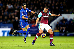 Riyad Mahrez of Leicester City challenges Winston Reid of West Ham United for the ball - Mandatory by-line: Robbie Stephenson/JMP - 31/12/2016 - FOOTBALL - King Power Stadium - Leicester, England - Leicester City v West Ham United - Premier League