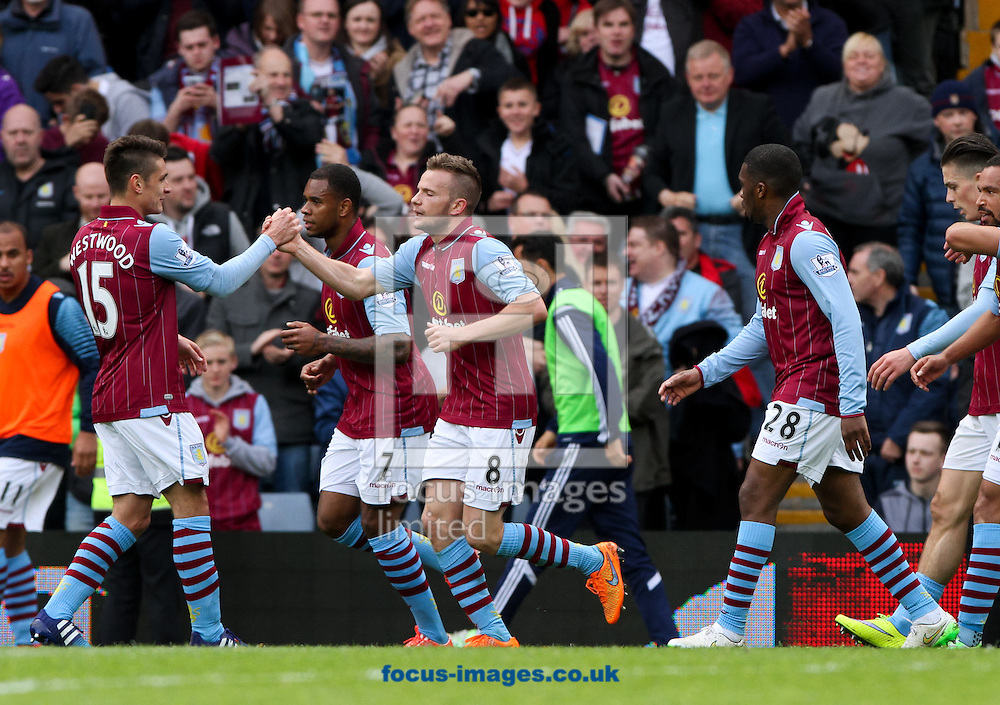 Tom Cleverley (centre) of Aston Villa celebrates scoring his sides first goal with his team mates during the Barclays Premier League match at Villa Park, Birmingham<br /> Picture by Tom Smith/Focus Images Ltd 07545141164<br /> 09/05/2015