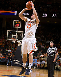 Virginia guard Sammy Zeglinski (13) shoots a three point jump shot against Xavier.  The #22 ranked Xavier Musketeers defeated the Virginia Cavaliers 84-70 at the John Paul Jones Arena on the Grounds of the University of Virginia in Charlottesville, VA on January 3, 2009.