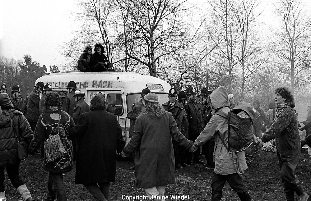 Police preparing to remove and arrest protesters from the police van at the anti-nuclear Greenham Common Women's Peace Camp in 1983 / 1984. The women only camp surrounded the RAF  base in Berkshire (UK) where American cruise missiles were being stored.
