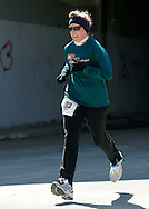 Mamakating, New York - A female runner competes in the Wurtsboro Mountain 30K road race on March 20, 2011.
