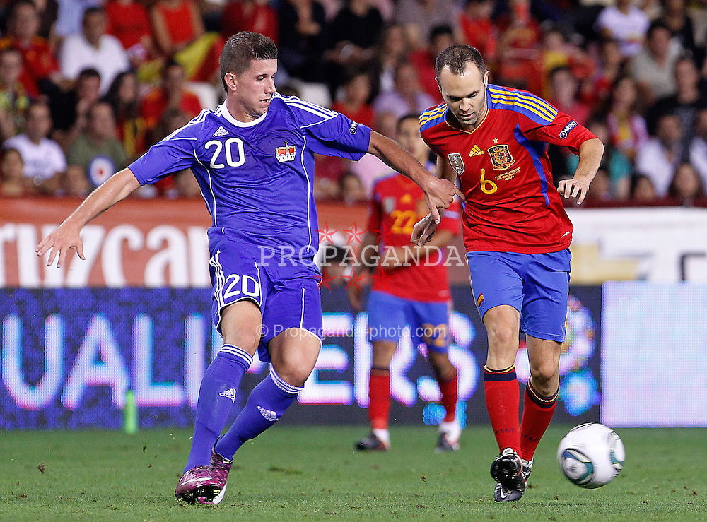 06.09.2011, Logrono, ESP, UEFA EURO 2012, Qualifikation, Spanien vs Lichtenstein, im Bild Spain's Andres Iniesta (r) and Liechtenstein's Sandro Wieser during Euro 2012 qualifier match.September 6,2011.. EXPA Pictures © 2011, PhotoCredit: EXPA/ Alterphoto/ Acero +++++ ATTENTION - OUT OF SPAIN/(ESP) +++++