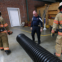 Saltillo Fire Department Chief Mark Nowell, center, Captain Jamie Thomas, and Deputy Chief Chris Jenkins set up the confined space tunnel for theur training exercise on Friday afternoon.