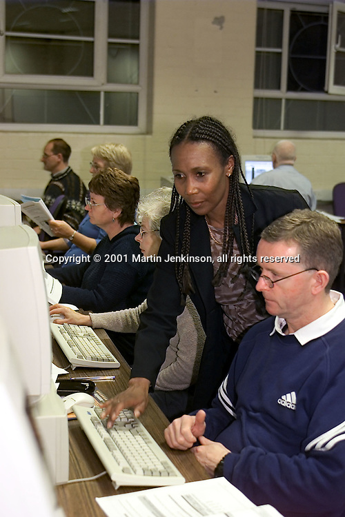 Lecturer Marcia Parke with Steve Marsden, Wyke Manor Secondary on an ICT course at Bradford & Ilkley Community College..© Martin Jenkinson tel 0114 258 6808  mobile 07831 189363 email martin@pressphotos.co.uk  NUJ recommended terms & conditions apply. Copyright Designs & Patents Act 1988. Moral rights asserted credit required. No part of this photo to be stored, reproduced, manipulated or transmitted by any means without prior written permission.