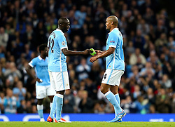 Manchester City captain, Vincent Company hands the arm band to Yaya Toure during the UEFA Champions League group stage match between Manchester City and Juventus at the Etihad Stadium - Mandatory byline: Matt McNulty/JMP - 07966386802 - 15/09/2015 - FOOTBALL - Etihad Stadium -Manchester,England - Manchester City v Juventus - UEFA Champions League - Group D