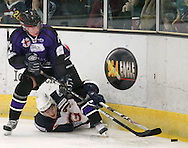 16 Jan 2010: Guildford, England. Tom Duggan (19) of Guildford Flames is floored by a bodycheck from Jaakko Hagelberg (44) of Manchester Phoenix during the English Premier League match between Guildford Flames  Manchester Phoenix at Guildford (photo by Andrew Tobin/Slik Images)