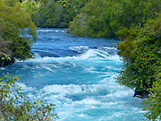 The Huka Falls are a set of waterfalls on the Waikato River that drains Lake Taupo in New Zealand.