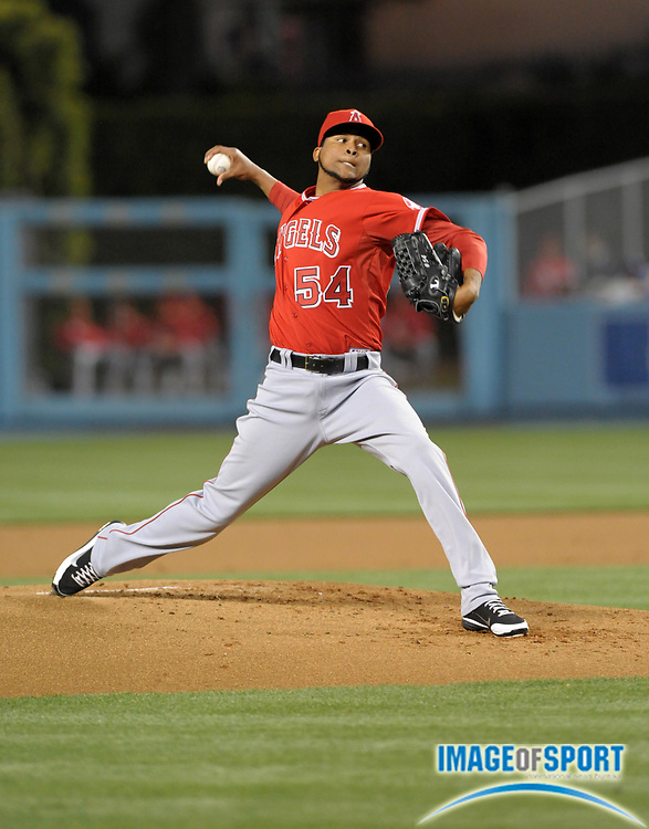 Apr 3, 2012; Los Angeles, CA, USA; Los Angeles Angels starter Ervin Santana (54) delivers a pitch against the Los Angeles Dodgers at Dodger Stadium.
