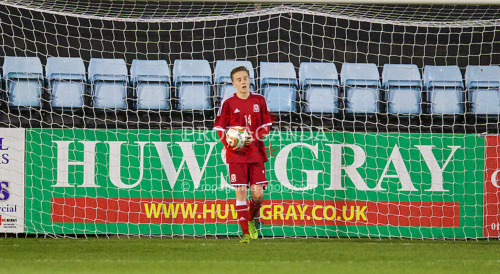 RHYL, WALES - Tuesday, March 18, 2014: Wales' Theo Llewellyn looks dejected as Poland score a third goal during the Under-15's International Friendly match at Belle Vue. (Pic by David Rawcliffe/Propaganda)