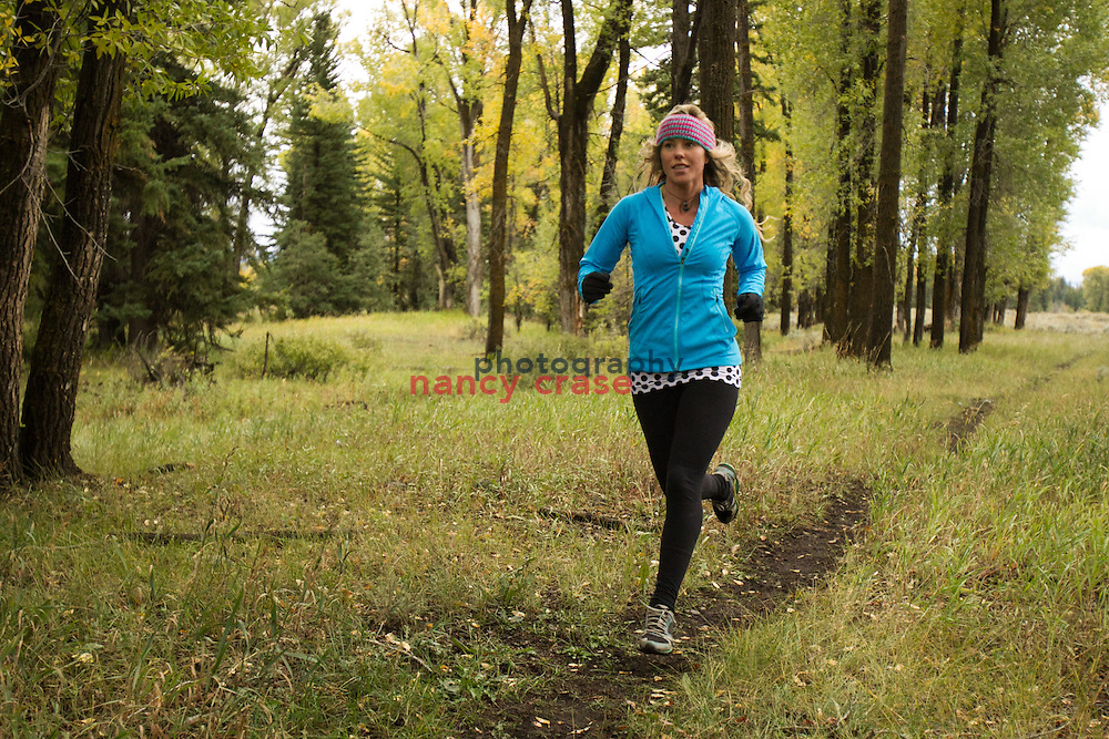 Running in Summit Adventure Workshop in Jackson Hole, WY on Sept 25, 2013<br /> <br /> Lynsey Dyer running in blue top and black tights.