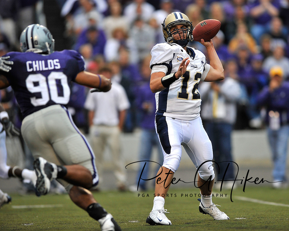MANHATTAN, KS - SEPTEMBER 06:  Quarterback Cody Kempt #12 of the Montana State Bobcats gets ready to throw down field against pressure from defensive end Eric Childs #90 of the Kansas State Wildcats in the first quarter on September 6, 2008 at Bill Snyder Family Stadium in Manhattan, Kansas.  Kansas State won 69-10.