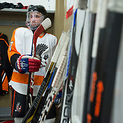 Kevin Hodsdon gets ready<br /> to head out to the rink before the 2015 State Hockey Championships at the Curtis D. Menard Memorial Sports Center Saturday night. WHS won 4-3.