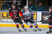 KELOWNA, CANADA - FEBRUARY 18: Radovan Bondra #24 of the Prince George Cougars is checked by Kyle Topping #24 of the Kelowna Rockets on February 18, 2017 at Prospera Place in Kelowna, British Columbia, Canada.  (Photo by Marissa Baecker/Shoot the Breeze)  *** Local Caption ***