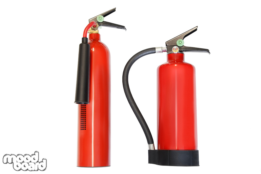 Two fire extinguishers against white background