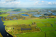 Nederland, Friesland, Alde Feanen, 10-10-2014;<br /> De Oude Venen, met geisoleerde boerderij. Eernewoude rechts aan de horizon. Links Prinses Margrietkanaal.<br /> The old peatlands, Frisian peatland and bog, nature reserve.<br /> luchtfoto (toeslag op standard tarieven);<br /> aerial photo (additional fee required);<br /> copyright foto/photo Siebe Swart
