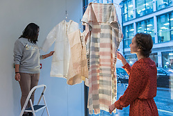 """© Licensed to London News Pictures. 20/11/2018. LONDON, UK. Staff members hang textiles by Hala Kaisow. Preview of """"Accumulation:  Legacy and Memory"""", an exhibition presented by Art Bahrain Across Borders during Bahrain Art Week.  Works from 11 emerging and established Bahraini artists is on display 20th to 26 November at Alon Zakaim Fine Art gallery in Mayfair.  Photo credit: Stephen Chung/LNP"""