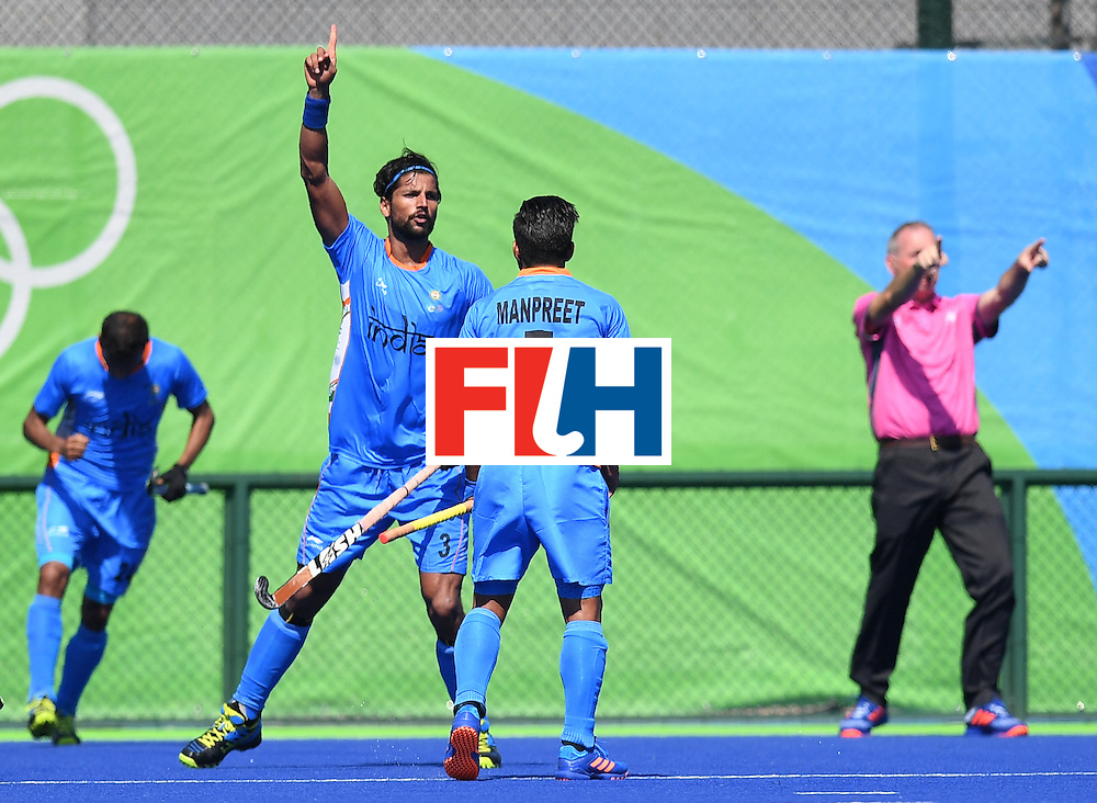 India's Rupinder Pal Singh (C) celebrates scoring a goal during the men's field hockey India vs Ireland match of the Rio 2016 Olympics Games at the Olympic Hockey Centre in Rio de Janeiro on August, 6 2016. / AFP / MANAN VATSYAYANA        (Photo credit should read MANAN VATSYAYANA/AFP/Getty Images)