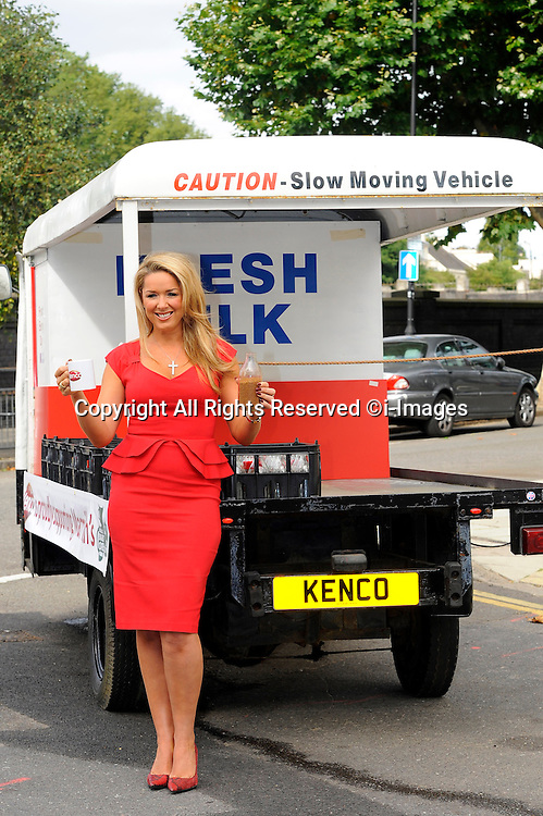 UK actress and TV presenter, Claire Sweeney, will be waking up Londoners with the smell of coffee as she travels through Mornington Terrace in Camden on a coffee scented Kenco milk float. Claire has teamed up with Kenco, the official coffee partner for Macmillan's World's Biggest Coffee Morning, to hold her own Macmillan coffee morning. Wednesday September 2012. Photo By Chris Joseph/i-Images