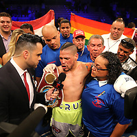 KISSIMMEE, FL - JULY 15: Orlando Cruz celebrates his victory over Alejandro Valdez during a boxing match at the Kissimmee Civic Center on July 15, 2016 in Kissimmee, Florida. Cruz was the first professional boxer to announce himself as gay and recently lost four friends in the Pulse Nightclub shooting in Orlando, he dedicated this match to his lost friends and won the bout by TKO in the 7th round.  (Photo by Alex Menendez/Getty Images) *** Local Caption *** Orlando Cruz; Alejandro Valdez