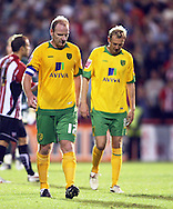London - Tuesday, August 18th, 2009: Dejected Gary Doherty (left and Stephen Hughes of Norwich  after the game between Brentford and Norwich City during the Coca Cola League One match at Griffin Park, London. (Pic by Chris Ratcliffe/Focus Images)