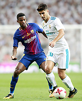 Real Madrid's Marco Asensio (r) and FC Barcelona's Nelson Semedo during Supercup of Spain 2nd match. August 16,2017. (ALTERPHOTOS/Acero)