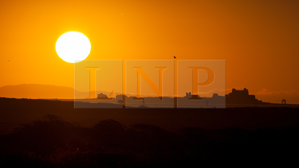 © Licensed to London News Pictures. 12/11/2017. Barrow-in-Furness, UK.  The sun rises over Roa Island and Piel Castle near Barrow-in-Furness in Cumbria this morning, Remembrance Sunday, 12th November 2017.  Photo credit: Rob Arnold/LNP