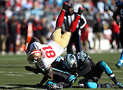 San Francisco 49ers wide receiver Anquan Boldin (81) gets upended by Carolina Panthers free safety Mike Mitchell (21) and Carolina Panthers cornerback Melvin White (23) after catching a 15 yard pass good for a first down at the Carolina Panthers 9 yard line with 53 seconds left in the second quarter during the NFC Divisional Playoff NFL football game against the Carolina Panthers on Sunday, Jan. 12, 2014 in Charlotte, N.C. The 49ers won the game 23-10. ©Paul Anthony Spinelli