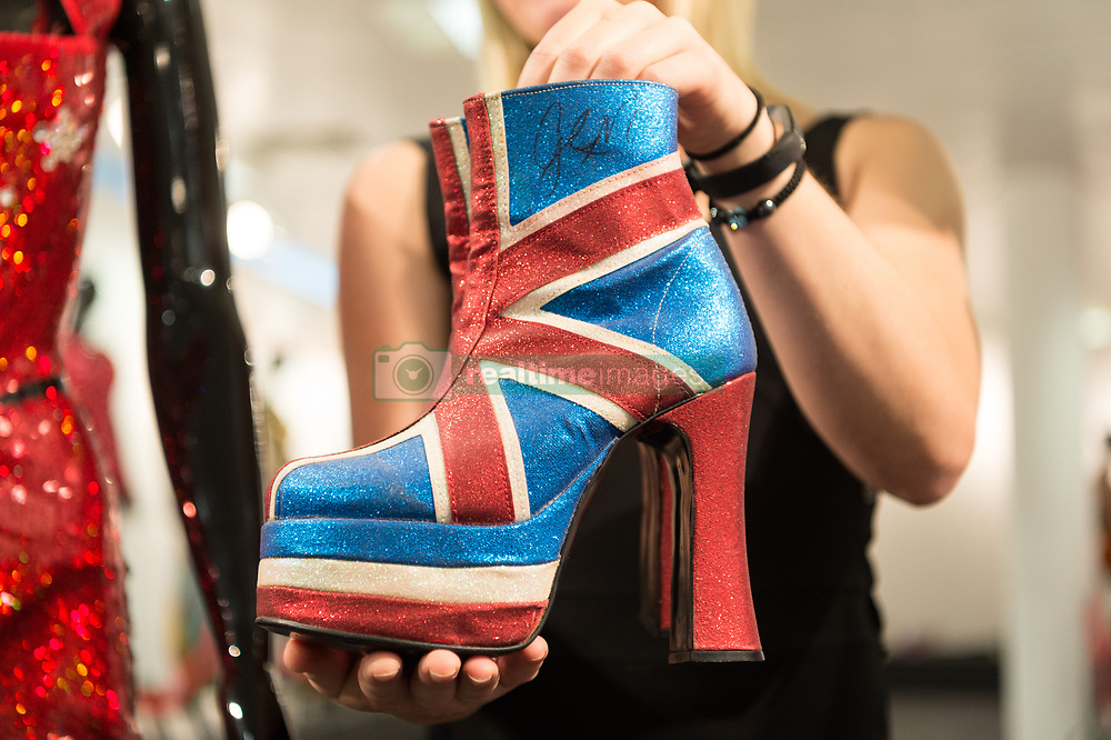 July 26, 2018 - London, London, UK - London, UK.  A pair of boots worn by Geri Halliwell are on display at the Spice Girls exhibition. The interactive exhibition features hundreds of iconic stage, music video and film costumes worn by the popular 90s girl band at Business Design Centre/ (Credit Image: © Ray Tang/London News Pictures via ZUMA Wire)