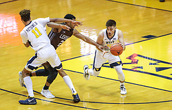 Dec 30, 2018; Morgantown, WV, USA; West Virginia Mountaineers guard Jordan McCabe (5) steals the ball during the first half against the Lehigh Mountain Hawks at WVU Coliseum. Mandatory Credit: Ben Queen-USA TODAY Sports
