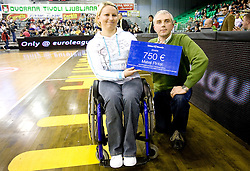 Mateja Pintar receiving donations from Telekom Slovenije at Group C of Euroleague basketball match between KK Union Olimpija, Slovenia and Caja Laboral, Spain, on November 5, 2009, in Arena Tivoli, Ljubljana, Slovenia.  (Photo by Vid Ponikvar / Sportida)