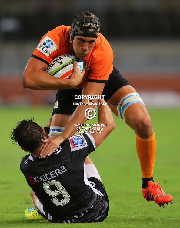 DURBAN, SOUTH AFRICA, 5, MARCH, 2016 -  Cobus Reinach of the Cell C Sharks looks to tackle Guido Petti of the Jaguares during The Cell C Sharks vs Jaguares Super Rugby match at Growthpoint Kings Park in Durban, South Africa. (Photo by Anesh Debiky)