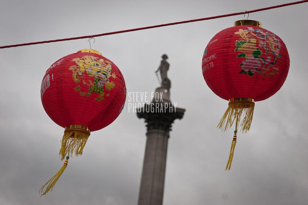 Nelsons Column framed between two lanterns, Chinese New Year 2011, Trafalgar Square, London, England