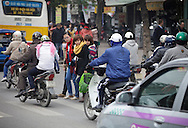 Pedestrians try to cross the road between raffic in Hanoi, Vietnam on Jan 11, 2013..(Photo by Kuni Takahashi)