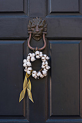December 21, 2017 - Charleston, South Carolina, United States of America - A low country style Christmas wreath made from cotton balls hangs from a historic home along Chalmers Street in Charleston, SC. (Credit Image: © Richard Ellis via ZUMA Wire)