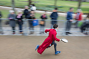 UNITED KINGDOM, Winchester: 05 March 2019 Winchester Pancake Race Photo Feature:<br /> A member belonging to the Winchester Cathedral Choir competes at the Inaugural Winchester Pancake Race earlier this afternoon on Shrove Tuesday. The race, which consisted of 20 teams, took place in the gardens surrounding Winchester Cathedral. <br /> Rick Findler / Story Picture Agency