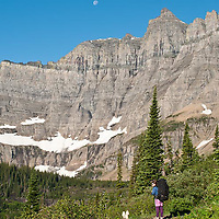 hiking glacier national park, woman backpacker hiking iceberg lake trail