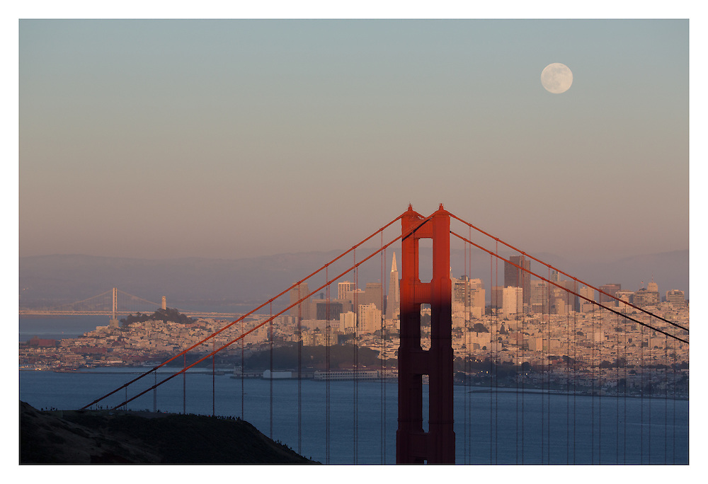 The Super Moon rises just before sunset on Saturday, June 22, 2013 over the Golden Gate Bridge in San Francisco. (Charles Hall/challphotos.com)