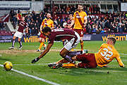 Hearts FC Forward Osman Sow gets a touch tackle during the Ladbrokes Scottish Premiership match between Heart of Midlothian and Motherwell at Tynecastle Stadium, Gorgie, Scotland on 16 January 2016. Photo by Craig McAllister.