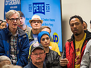 28 DECEMBER 2019 - DES MOINES, IOWA: People listen to Mayor Pete Buttigieg during a meet and greet in Des Moines. Buttigieg talked to a crowd of about 75 people at Urban Dreams, an African-American community empowerment center in Des Moines. It was a part of Buttigieg's continuing outreach to African-American voters. Buttigieg, the mayor of South Bend, Indiana, is running to be the Democratic nominee for President in the 2020 election. Iowa traditionally holds the first presidential selection event of the 2020 election cycle. The Iowa Caucuses are on Feb. 3, 2020.           PHOTO BY JACK KURTZ