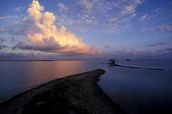 Stock photo of a sunset view of Galveston Bay from a jetty
